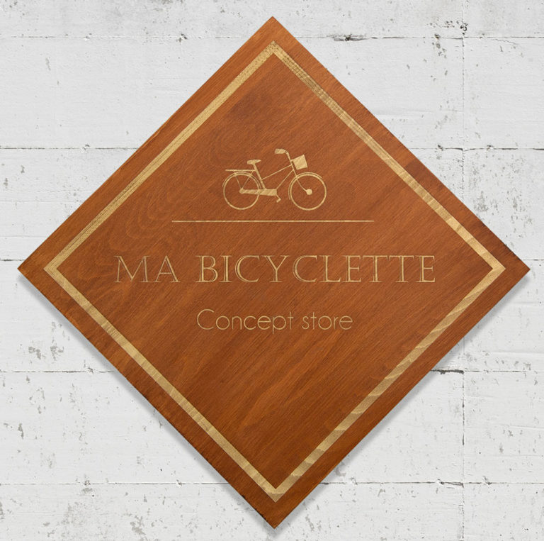 enseigne bois or, dorée vélo